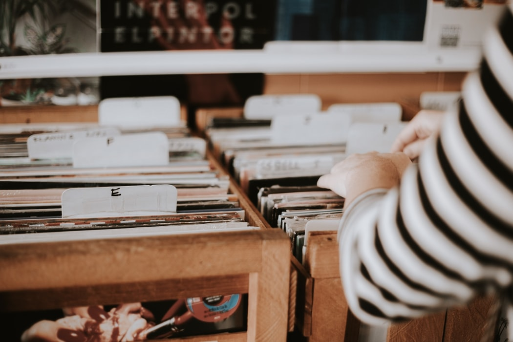 A person looking at records in a shop