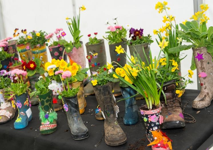 Children's wellies filled with flowers
