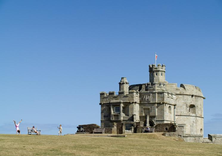 Family play outside Pendennis Castle in Falmouth, Cornwall