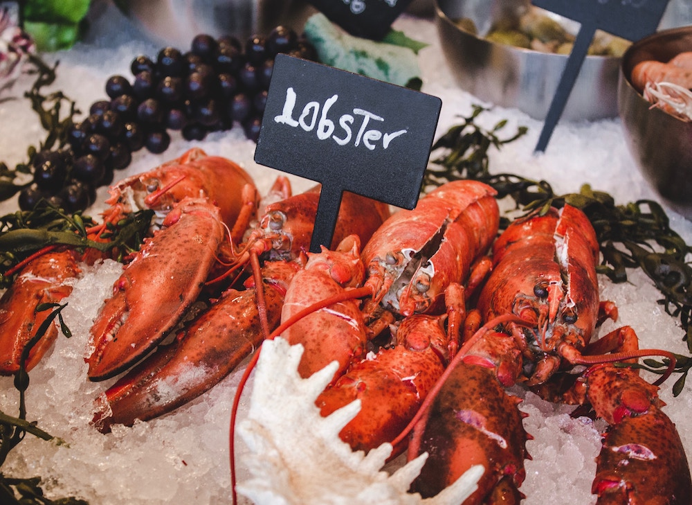 Lobsters on ice being sold at a market
