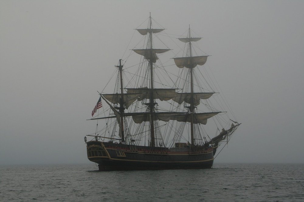 An old boat in the misty sea