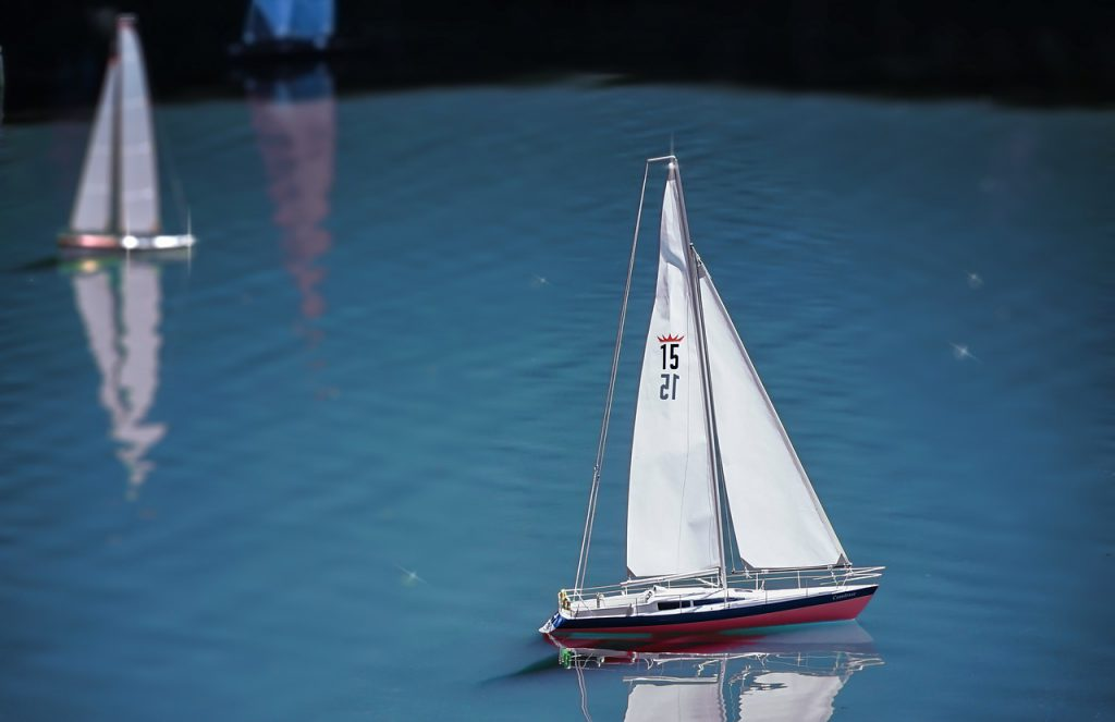 Model boats sailing on water