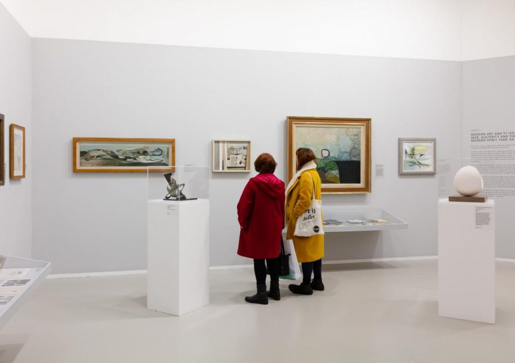 Two people looking at art in the Tate
