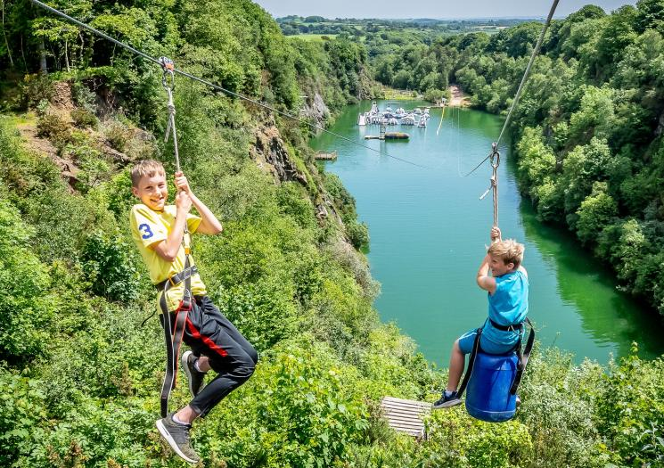 Two boys on the zip wire at Adrenalin Quarry
