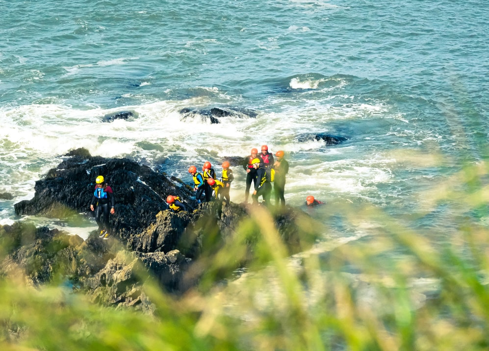 A group taking part in coasteering