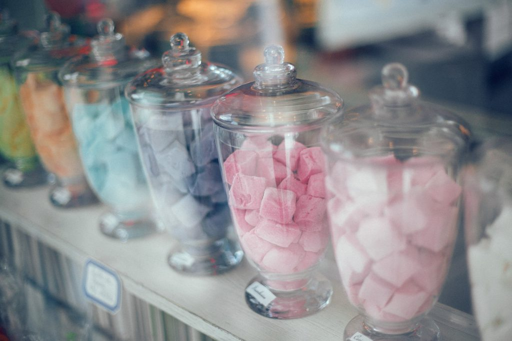 Glass jars full of different coloured sweets