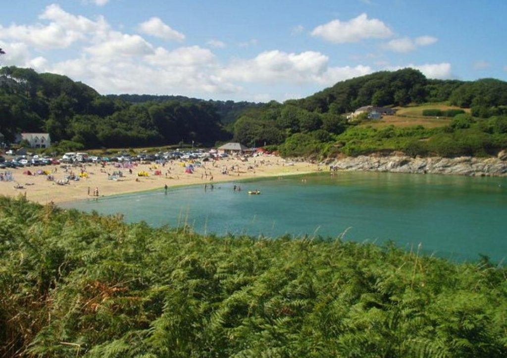 Lush waters and green scenery at Maenporth Beach