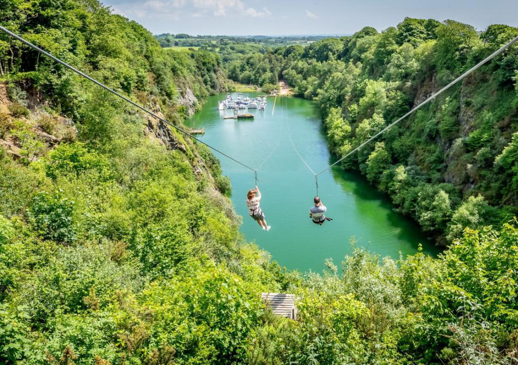Two people on the zip wire at Adrenalin Quarry
