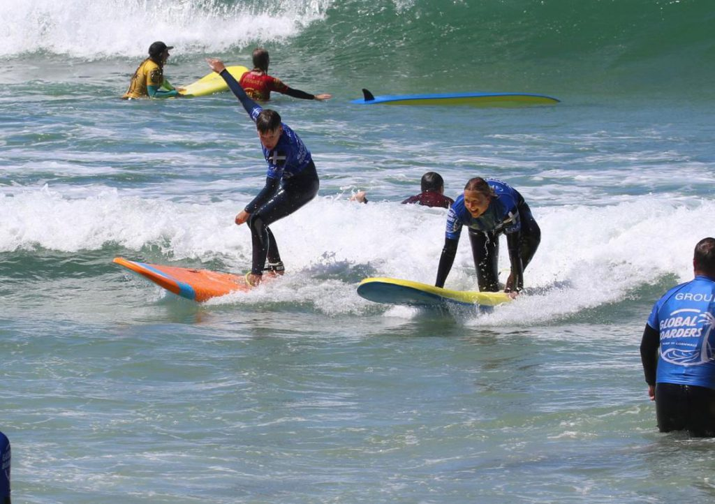 A group of surfers in the sea