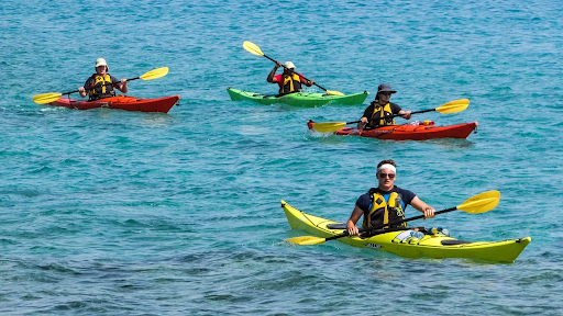 A group of kayakers in the sea